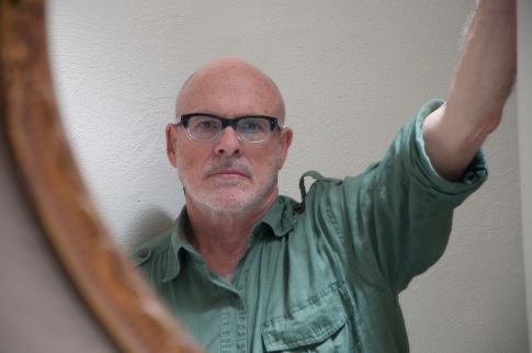 Photograph of Dan Rose in a mirror by Rachel Cheetham-Richard